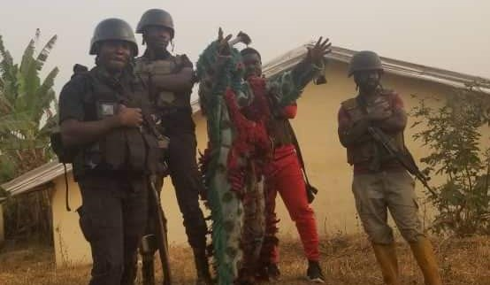 Photo of Abomination! Mbiame 'Juju' Takes Selfie With Soldiers